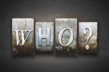 The word WHO? written in vintage letterpress type