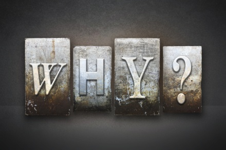 The question WHY? written in vintage letterpress type
